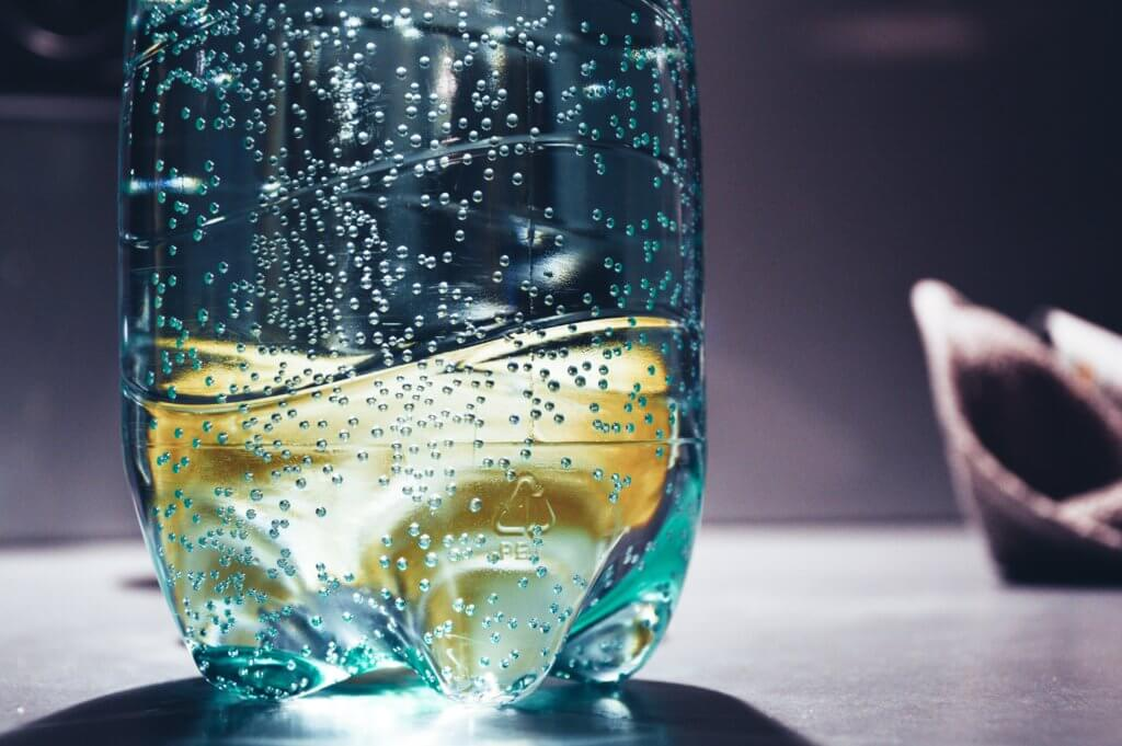 Carbios makes clear plastic bottles from recycled textile waste